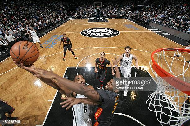 Alan Anderson of the Brooklyn Nets shoots the ball against Festus Ezeli of the Golden State Warriors during the game on March 2 2015 at Barclays...