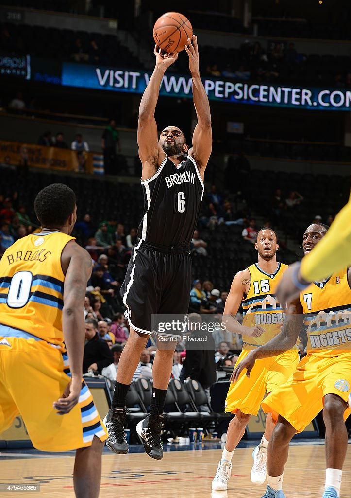 Alan Anderson #6 of the Brooklyn Nets takes a shot during a game against the Denver Nuggets on February 27, 2014 at the Pepsi Center in Denver, Colorado.