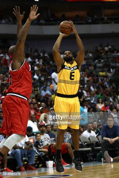 Alan Anderson of the Killer 3s shoots the ball over Al Harrington of Trilogy during week nine of the BIG3 threeonthree basketball league at the...