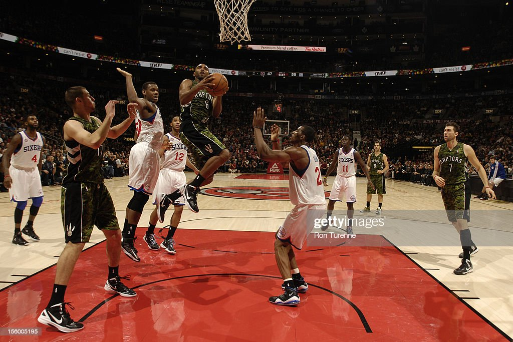 Alan Anderson #6 of the Toronto Raptors drives to the basket against defenders during the game on November 10, 2012 at the Air Canada Centre in Toronto, Ontario, Canada.