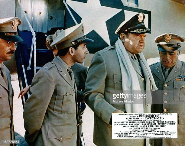 Alan Arkin and Martin Balsam to the left and right of Orson Welles in a scene from the film 'Catch22' 1970