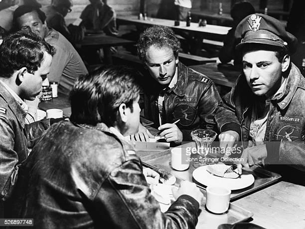 Alan Arkin as Captain John Yossarian and Art Garfunkel as Captain Nately in the film version of Heller's Catch-22 .