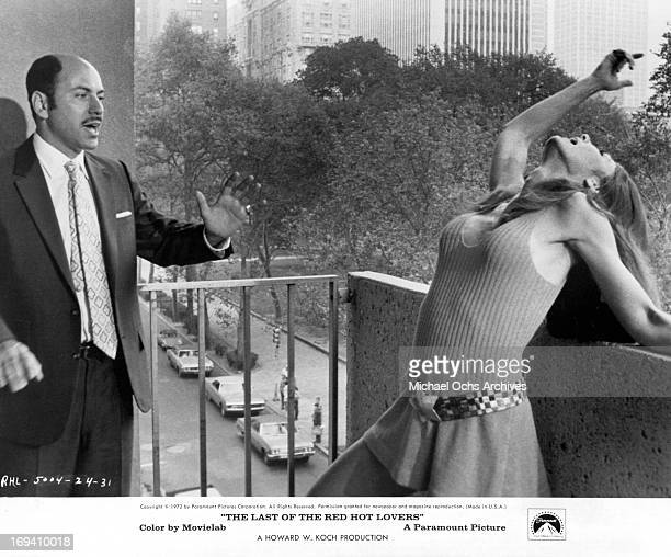 Alan Arkin watching the theatrics of Paula Prentiss on the balcony in a scene from the film 'Last Of The Red Hot Lovers' 1972