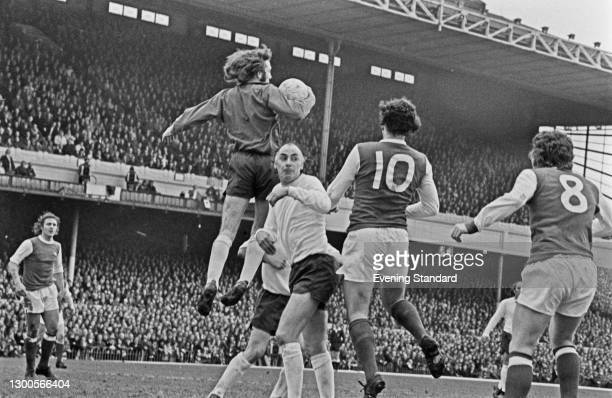 Alan Ball Jr and Ray Kennedy of Arsenal flank Alan Gilzean of Tottenham Hotspur during a League Division One match at Highbury Stadium in London, UK,...