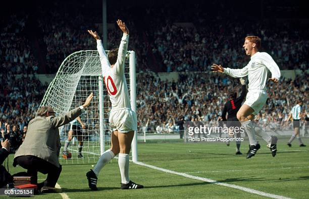 Alan Ball runs in to congratulate Geoff Hurst who has scored England's winning goal in the 78th minute of the World Cup quarter-final match between...