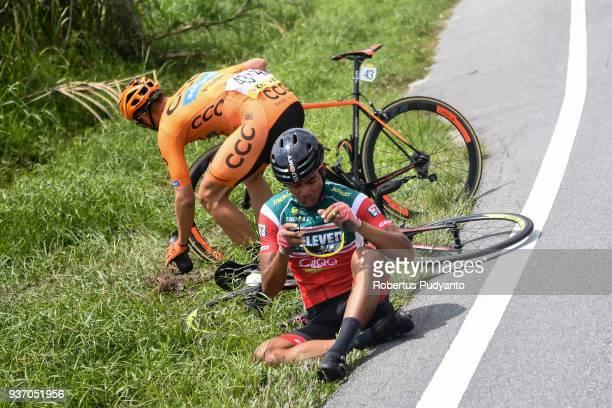 Alan Banaszek of CCC Sprandi Polkowice Poland crashes with Bonjoe Martin of 7 ElevenCliqq Roadbike Philippines during Stage 6 of the Le Tour de...