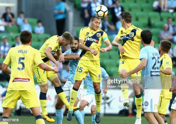 Alan Baro Calabuig of Central Coast Mariners heads the ball out of defence during the round 10 ALeague match between Melbourne City FC and the...