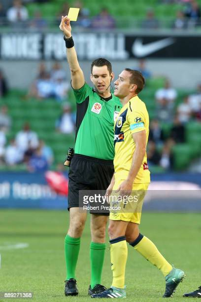 Alan Baro Calabuig of Central Coast Mariners is shown a yellow card during the round 10 ALeague match between Melbourne City FC and the Central Coast...