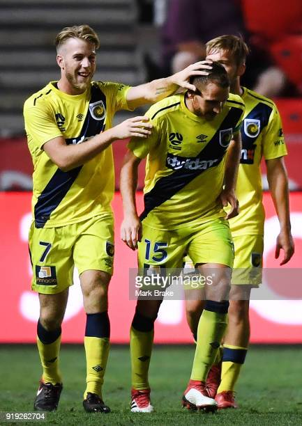 Alan Baro Calabuig of the Mariners and Andrew Hoole of the Mariners celebrate a goal during the round 20 ALeague match between Adelaide United and...
