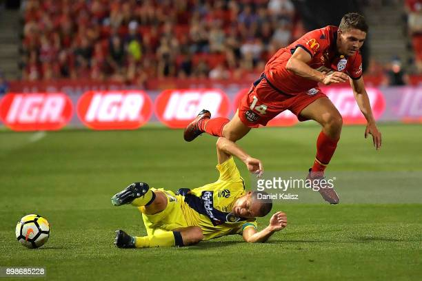 Alan Baro Calabuig of the Mariners and George Blackwood of United collide during the round 12 ALeague match between Adelaide United and the Central...
