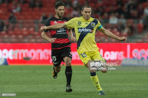 Alan Baro Calabuig of the Mariners clears the ball in front of Wanderers Alvaro Cejudo during the round two ALeague match between the Western Sydney...