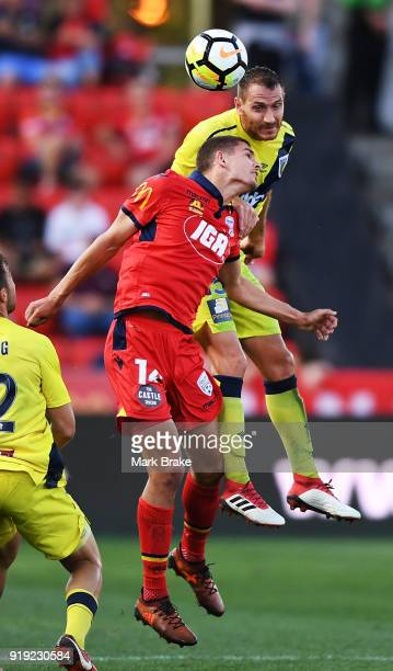 Alan Baro Calabuig of the Mariners heads over George Blackwood of Adelaide United during the round 20 ALeague match between Adelaide United and the...