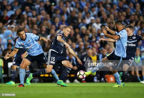Alan Baro of Melbourne Victory competes for the ball against Alex Brosque of Sydney FC during the 2017 ALeague Grand Final match between Sydney FC...