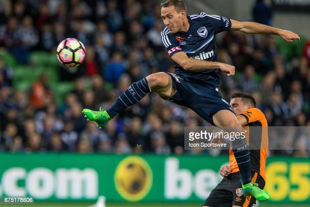 Alan Baro of Melbourne Victory flys and kicks the ball in front of a Brisbane Roar player during the Semi Final Match of the Hyundai ALeague Finals...