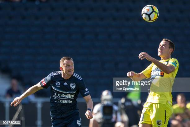 Alan Baro of the Central Coast Mariners heads the ball in front of Besart Berisha of Melbourne Victory during Round 14 of the Hyundai ALeague Series...