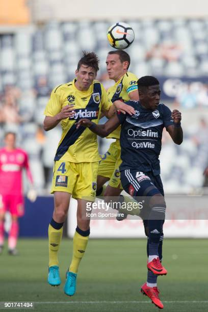Alan Baro of the Central Coast Mariners Jake McGing of the Central Coast Mariners and Leroy George of Melbourne Victory all contest the ball during...