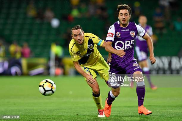 Alan Baro of the Mariners and Jacob Italiano of the Glory contest the ball during the round 22 ALeague match between the Perth Glory and the Central...