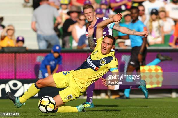 Alan Baro of the Mariners attempts to block a cross by Andy Keogh of the Glory during the round three ALeague match between Perth Glory and the...