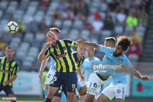 Alan Baro of the Mariners contests a header with Osama Malik of City during the round 16 ALeague match between the Central Coast Mariners and...