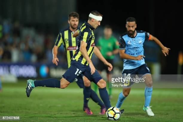 Alan Baro of the Mariners contests the ball with Alex Brosque of Sydney during the round six ALeague match between the Central Coast Mariners and...