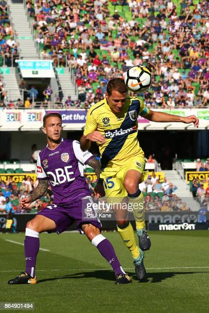 Alan Baro of the Mariners heads the ball against Adam Taggart of the Glory during the round three ALeague match between Perth Glory and the Central...