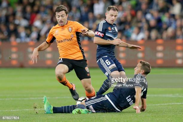 Alan Baro of the Victory tackles Tommy Oar of the Roar during the ALeague Semi Final match between Melbourne Victory and the Brisbane Roar at AAMI...