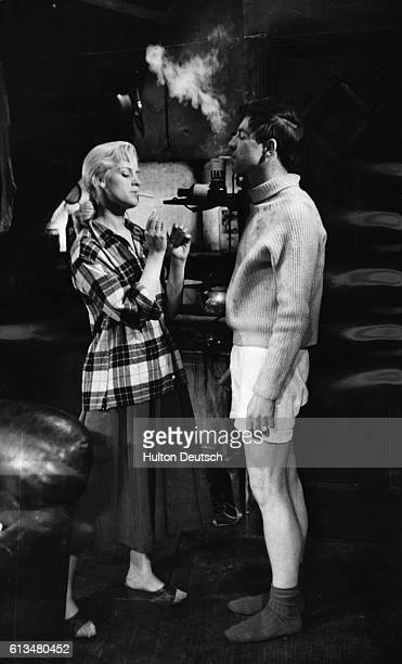 Alan Bates as Cliff Lewis and Mary Ure as Alison Porter in John Osborne's acclaimed play Look Back in Anger at the Royal Court Theatre, 1956.