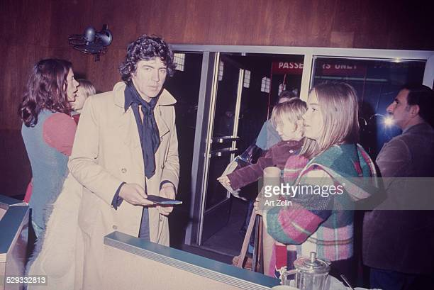 Alan Bates with his wife Victoria Ward and his twin sons Benedick and Tristan at a terminal gate circa 1970 New York