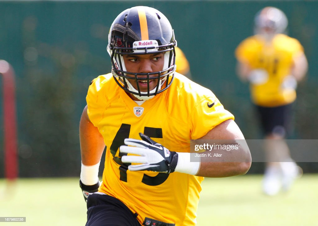 Alan Baxter #45 of the Pittsburgh Steelers participates in drills during Rookie Camp on May 3, 2013 at UPMC Sports Complex in Pittsburgh, Pennsylvania.