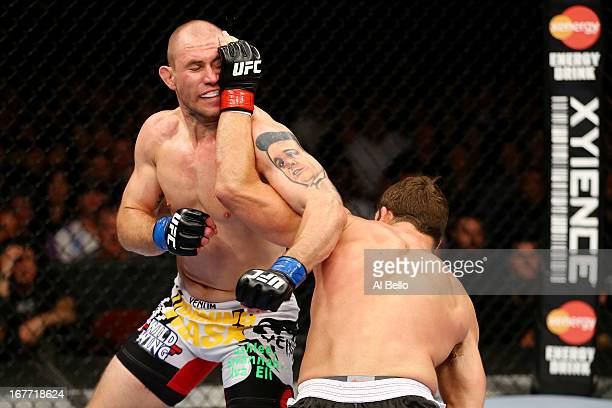 Alan Belcher battles against Michael Bisping of England in their middleweight bout during the UFC 159 event at the Prudential Center on April 27 2013...