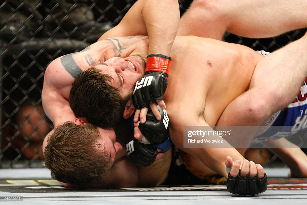 Alan Belcher (bottom) holds on to Patrick Cote in their middleweight bout at UFC 113 at Bell Centre on May 8, 2010 in Montreal, Quebec, Canada. Alan Belcher won the bout by KO.