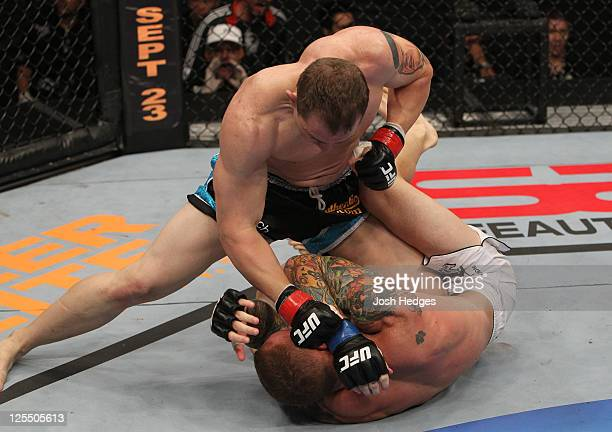 Alan Belcher punches down at Jason MacDonald during the UFC Fight Night event at the New Orleans Convention Center on September 17 2011 in New...