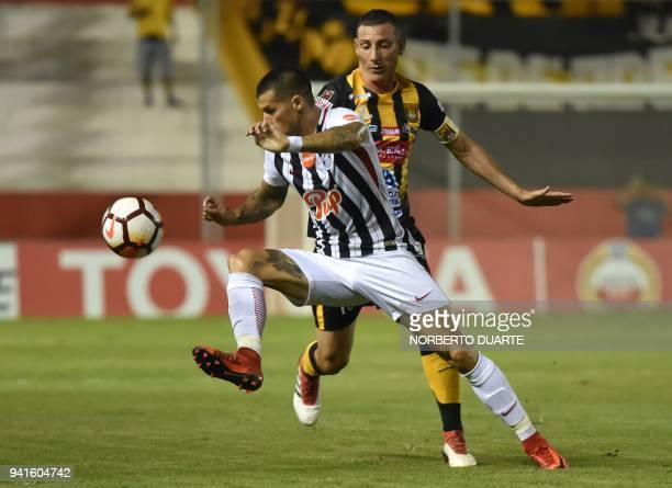 Alan Benitez of Paraguay's Libertad vies for the ball with Pablo Escobar of Bolivia's The Strongest during their 2018 Libertadores Cup football match...