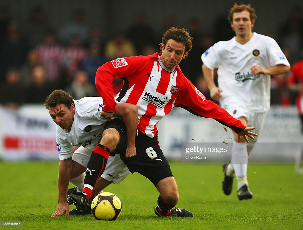 Alan Bennet of Brentford is challenged by Ian Simpemba of Havant & Waterlooville during the FA Cup 1st Round match between Havant & Waterlooville and Brentford at the Westleigh Park on November 9, 2008 in Havant, England.
