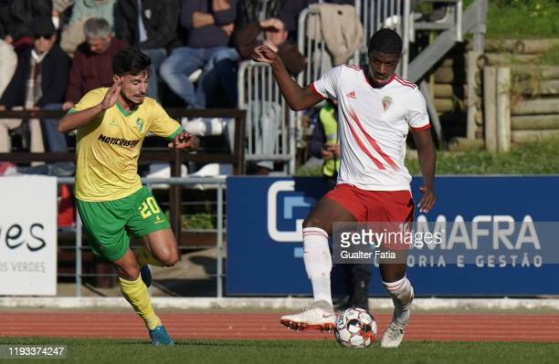 Alan Bidi of UD Vilafranquense with Nuno Tavares of CD Mafra in action during the Liga Pro match between CD Mafra and UD Vilafranquense at Estadio do...