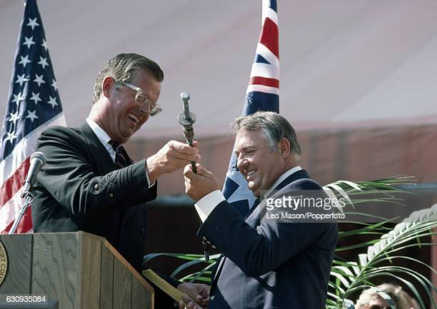 Alan Bond the Australian businessman and leader of the syndicate which owned the victorious Australia II receives the bolt which had held the trophy...