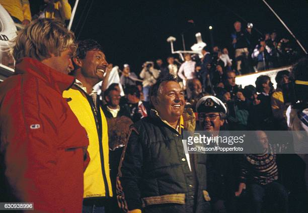 Alan Bond the Australian businessman and leader of the syndicate which owned the victorious Australia II celebrates with skipper Jean Bertrand after...