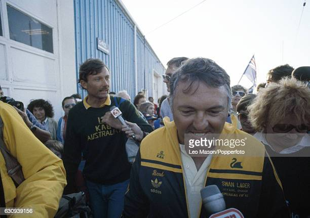Alan Bond the Australian businessman and leader of the syndicate which owned the victorious Australia II is interviewed on the quayside with skipper...