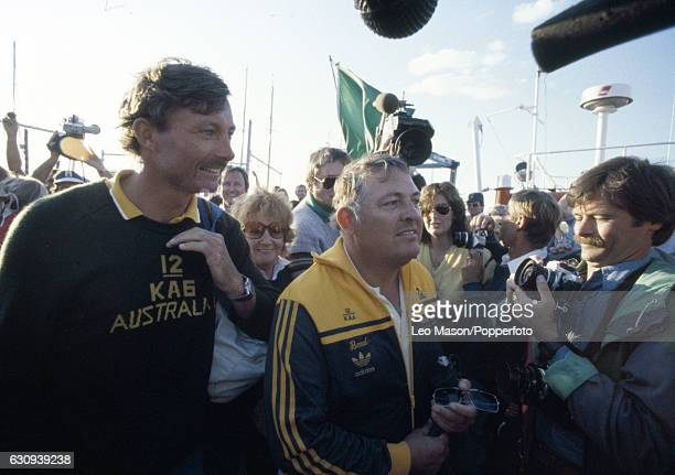 Alan Bond the Australian businessman and leader of the syndicate which owned the victorious Australia II on the quayside with skipper Jean Bertrand...