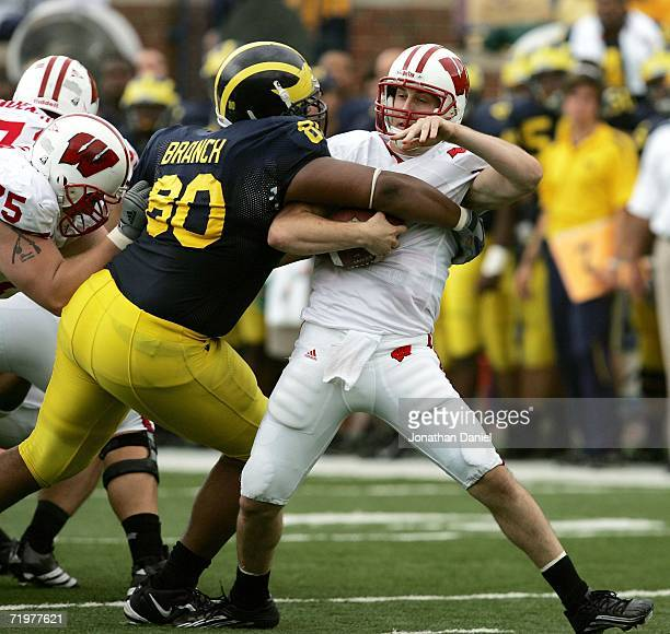 Alan Branch of the Michigan Wolverines sacks John Stocco of the Wisconsin Badgers on September 23 2006 at Michigan Stadium in Ann Arbor Michigan...