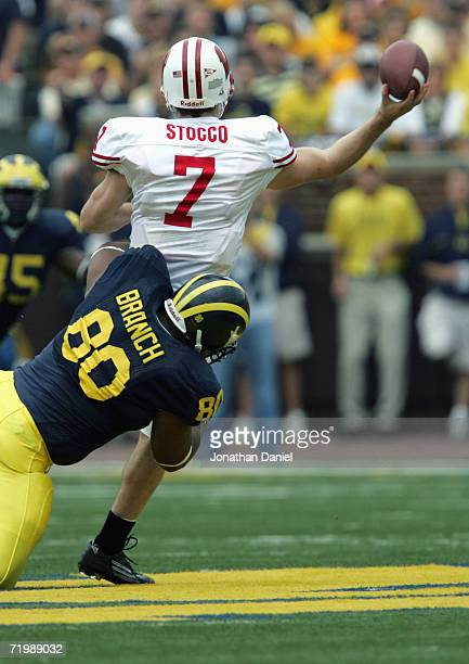 Alan Branch of the Michigan Wolverines tries to sack John Stocco of the Wisconsin Badgers during the game on September 23 2006 at Michigan Stadium in...