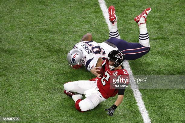 Alan Branch of the New England Patriots tackles Matt Ryan of the Atlanta Falcons during the third quarter of Super Bowl 51 at NRG Stadium on February...