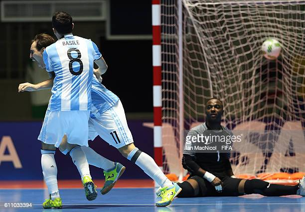 Alan Brandi of Argentina celebrates after he scows his teams fourth goal after he scores during the FIFA Futsal World Cup Semi Final match between...