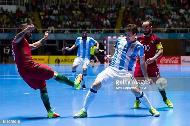Alan Brandi of Argentina competes for the ball with Joao Matos and Ricardinho of Portugal during the FIFA Futsal World Cup SemiFinal match between...