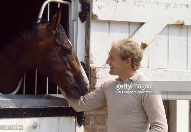Alan Brazil of Ipswich Town with the race horse Shergar in Newmarket England circa 1980
