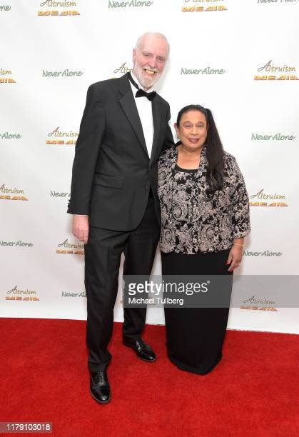 """Alan Brent and executive producer Diana Michael attend the premiere of the film """"Never Alone"""" at Arena Cinelounge on October 04, 2019 in Hollywood,..."""