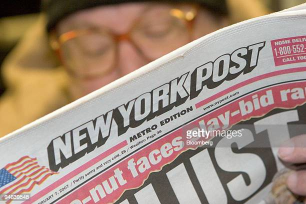 Alan Brown reads the New York Post newspaper while riding the T train through Cambridge Massachusetts Wednesday Feb 7 2007 News Corp said...