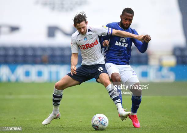 Alan Browne of Preston North End holds off a challenge from Junior Hoilett of Cardiff City during the Sky Bet Championship match between Preston...