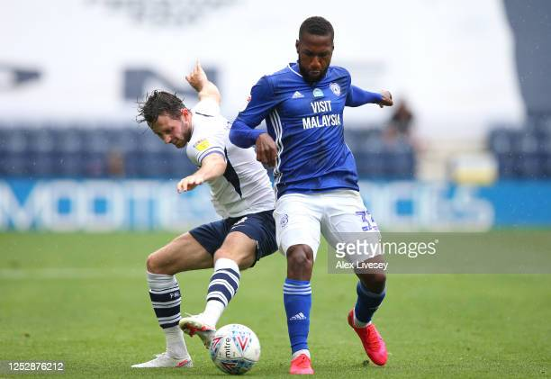 Alan Browne of Preston North End is tackled by Junior Hoilett of Cardiff City during the Sky Bet Championship match between Preston North End and...