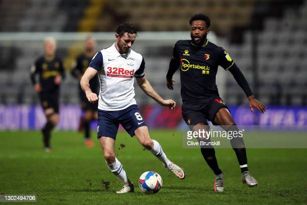Alan Browne of Preston North End passes the ball under pressure from Nathaniel Chalobah of Watford FC during the Sky Bet Championship match between...